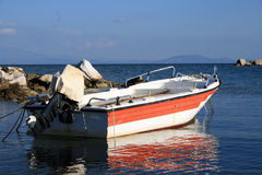 Small boat. A small boat in the calm sea in daylight Royalty Free Stock Image