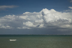 Small boat. On a clear sea but cloudy weather Stock Images