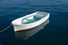 Small Boat. Small wooden boat on sea Royalty Free Stock Images