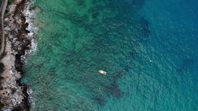 Small boat from above aerial shot. Small boat from aboves. Aerial shot stock footage