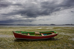Small boat aground Stock Photo