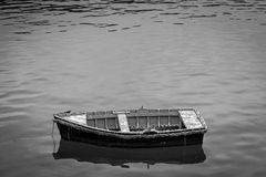 Small boat. Anchored at the entrance to a port Royalty Free Stock Photography