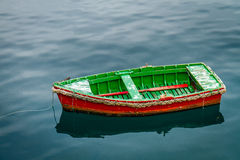 Small boat. Anchored at the entrance to a port Royalty Free Stock Image