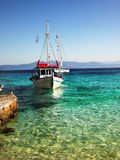 Small Boat. Anchored in the shallow bay. Greece Stock Photography