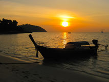 Small boat at the Andaman Sea in sunset Royalty Free Stock Images