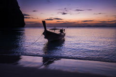 Small boat at the Andaman Sea at sunset Stock Photo
