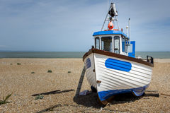 Small Boat on a Beach Stock Images
