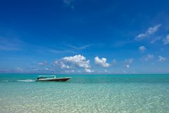 Small boat at beautiful ocean Stock Photo