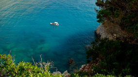 Small boat on beautiful sea in Lefkada island, Greece Stock Photo