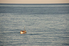 Small Boat, Big Ocean Royalty Free Stock Photos
