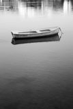 Small boat in black and white Royalty Free Stock Photo
