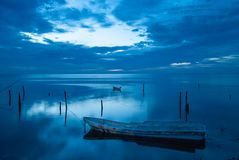 Small boat and the blue sunset in Campeche Mexico stock images