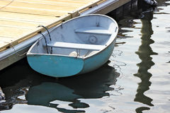 Small Boat. A small blue boat tied to a dock in Perkins Cove, Ogunquit, Maine Royalty Free Stock Image