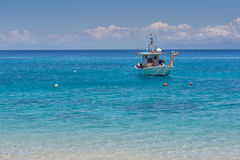 Small Boat in the Blue waters of Ionian sea Royalty Free Stock Image