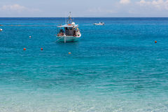 Small Boat in the Blue waters of Ionian sea Royalty Free Stock Photos