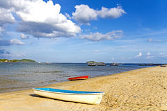 Small boat with bring sky Royalty Free Stock Photo