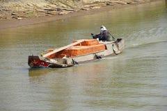 Small boat carries bricks Stock Photos