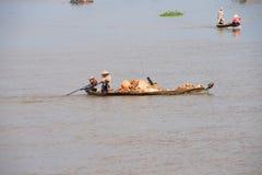 Small boat carries bricks Royalty Free Stock Photo
