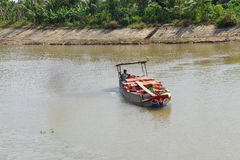 Small boat carries bricks Stock Photo