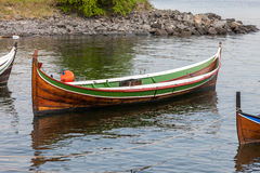 Small boat on clear water Stock Image