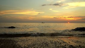 The small boat at the coast of the tropical island on evening walk. Bottom view. Boat on open sea sunset horizon. On this video you can see as the small stock footage