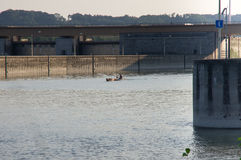 Small boat is coming out of the lock Royalty Free Stock Photography