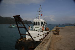 A small boat on Con Dao Island. A small fishing boat on a mooring well Con Dao Island Royalty Free Stock Photography
