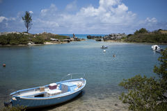Small Boat in Cove by the Ocean Royalty Free Stock Images