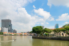 Small Boat Cruising the Straight along the Quay in Singapore Stock Photo