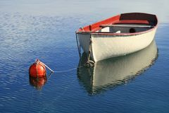 Small boat on the crystal blue sea of Losinj Croatia Stock Image