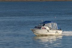 Small boat on Danube River. In a sunny day Stock Photos