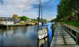 Small boat dock. A small boat docked in the waterway Royalty Free Stock Photos