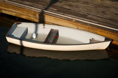 Small boat at dock Stock Photos