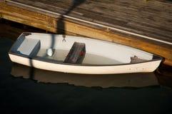 Small boat at dock Stock Photos