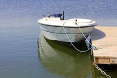 Small Boat by Dock Stock Image
