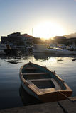 Small boat at dramatic sunset in Tivat Stock Photos