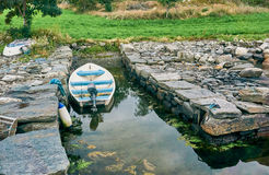 Small boat engine moored by the shore royalty free stock photo