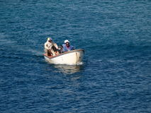 A small boat with fishermen in the caribbean. Royalty Free Stock Photography