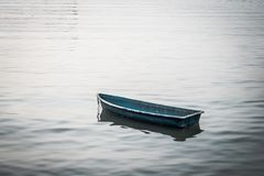 Small Boat Floating on the Lake stock photo