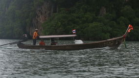 Small boat floating in the ocean stock video footage