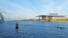 Small boat is floating on Oresund strait near Copenhagen Opera House in sunny autumn day stock video