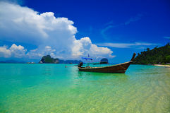Small boat floating on the paradise. Royalty Free Stock Photos