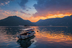 Small boat floats moored in Kotor Bay Stock Images