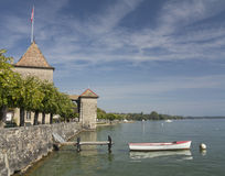 Small boat on the Geneva lake near the Chateau de Rolle Stock Photos
