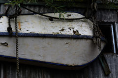 Small boat. A small boat hanging above a door as decoration Royalty Free Stock Images