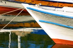 Small boat in harbor. Prow of small white boat moored in harbor Stock Photo