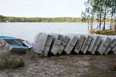 Free Small Boat In Aluminum Learning School Boats Overturned Rowboats On Dock Sand Lake Beach Royalty Free Stock Image - 175146536