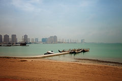 Small boat jetty by the beach in Doha, Qatar. Royalty Free Stock Photo