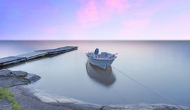 Small boat and jetty Royalty Free Stock Image