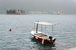 Small Boat. Kotor. Landscape of Kotor Bay in Montenegro. Two famous islands visible: Ostrvo Sveti Đorđe (Island of Saint George) and man made island Gospa od Stock Photos